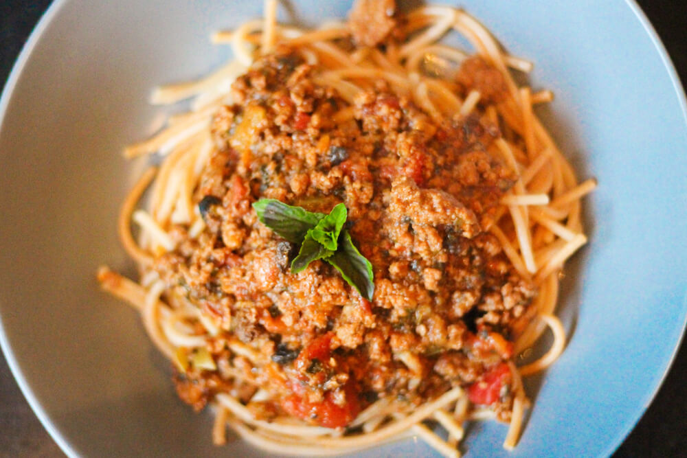Areial Shot: Home-made Spaghetti Bolognese in a blue bowl