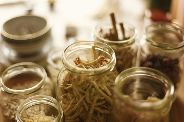 Open jars of Chinese herbal medicine