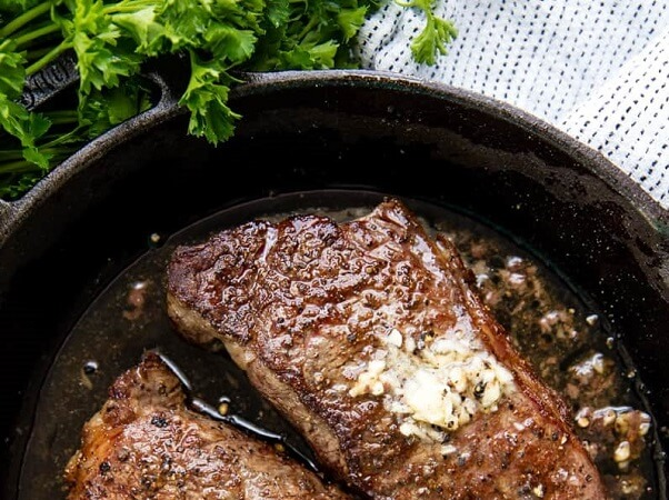 Learn how to cook steak perfectly every single time with this easy to follow recipe where steak is seared in a skillet on the stove and finished in the oven.